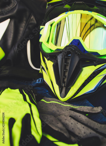 Cross helmet, gloves yellow fluorescent. Equipment for motorcycles. Enduro on the trip.