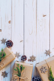 Homemade wrapped christmas gift box presents on a wood table background with space. - 234067028