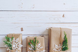 Homemade wrapped christmas gift box presents on a wood table background with space. - 234067474