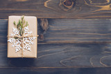 String or twine tied in a bow on kraft paper. Above gift box on wood with space. - 234067810