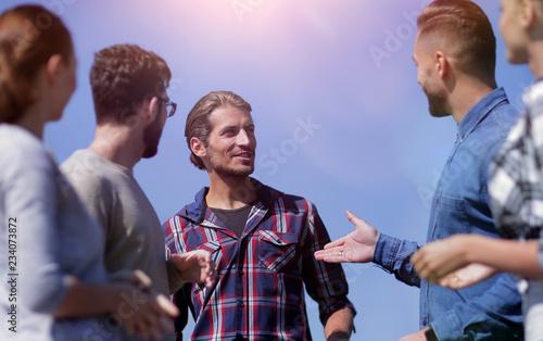 Leinwanddruck Bild closeup .a team of friends is discussing