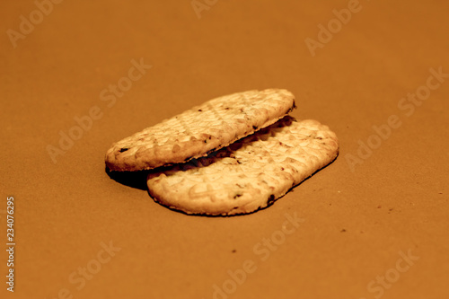 Perspective Shot Of Two Long Diet Biscuits On Dark Brown Background