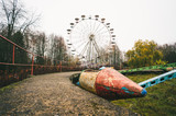 Abandoned soviet rocket carousel and ferris wheel - 234084439