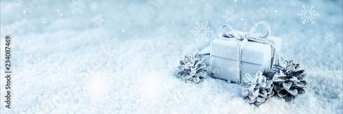 Leinwandbild Motiv Surprise gift in blue frosty snow
