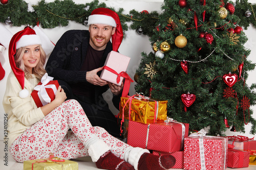Couple with Christmas gifts - 234101256