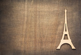 wooden eiffel tower toy at plywood background © Sergii Moscaliuk