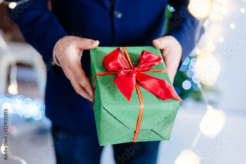 Man holding present in hand.