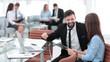 Leinwandbild Motiv business couple discussing working paper sitting at Desk