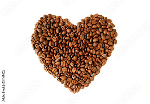 Top view of heap of roasted coffee beans in heart shaped isolated on white background - 234149402