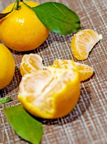 bright, juicy tangerines with green leaves. Cleaned tangerines. Vitamin C. Healthy vegetarian food.