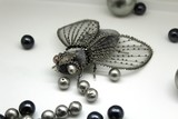 Brooch fly from beads.