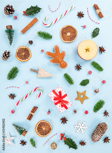 Christmas decorations on pastel color background. Top-down view.
