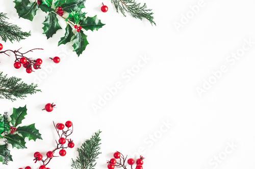 Leinwandbild Motiv Christmas composition. Frame made of christmas plants on white background. Flat lay, top view, copy space