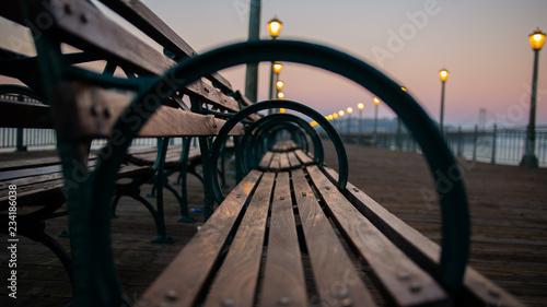 fototapeta na ścianę park bench at sunset