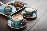 Two cup of coffee and with chocolate cookies