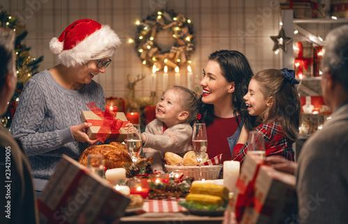 family celebrating Christmas - 234219005