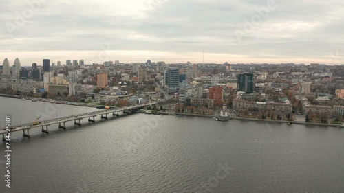 Obraz na płótnie 4K Aerial view footage of Dnieper river and city center skyline. Urban life from drone eye view. Flying over cityscape with buildings.
