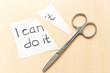 Concept of self belief, motivation an positive attitude. I can do it ,wrote on white torn paper.