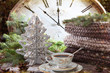 New year's composition with a Cup of coffee, a large vintage clock that shows the imminent onset of the New year. Gingerbread cookies in the form of Christmas trees with white glaze.