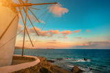 Picturesque view of sea with Mykonos windmill at sunset - 234250443