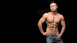 Attractive guy with perfect abs posing over dark background