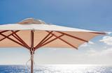 Parasol, vacances au soleil