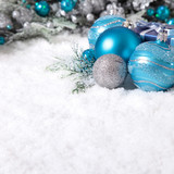 Christmas border with decoration and baubles on the snow square