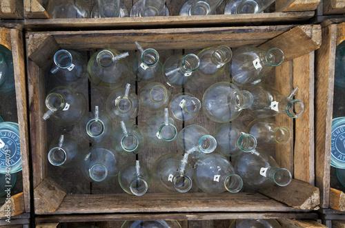 Empty bottles in the vintage wooden crate - Stock image © alexandernative