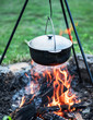 Leinwanddruck Bild - Cooking in the open-air. Cauldron over the campfire.