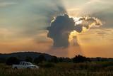 amazing human head shape cloud and sun light ray in saraburi thailand