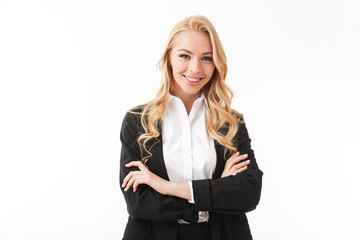 Photo of attractive businesswoman wearing office suit standing with arms crossed, isolated over white background in studio