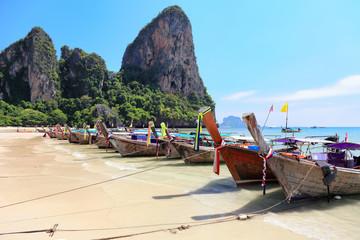 Long tail wooden boats stranded at Krabi Island beach, Thailand
