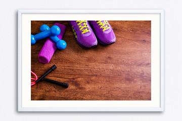 Fitness equipment. Sneakers, dumbbells and towel. © tanyastock