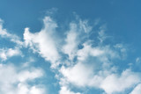 beautiful white clouds on a bright blue sky on a warm summer day
