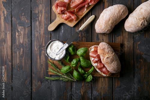 Home made ciabatta bread served with prosciutto - 234319838