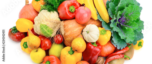 Fruits and vegetables isolated on a white. Wide photo .