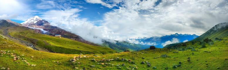 Panoramic view on Caucasus mountains with Kazbek mount peak © dzmitrock87