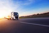 Loaded European truck on motorway in sunset - 234356424