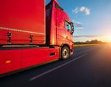 Loaded European truck on motorway in sunset - 234356622