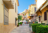 small cosy street of famous Placa old town district in Athens, Greece © neirfy