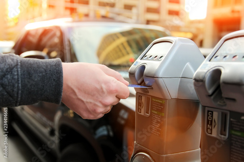 man is paying his parking using credit card at  parking pay station terminal - 234414665