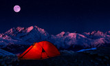 Night bivouac in Mountains, milion star hotel under night sky, red illuminated tent on pass in Alps. - 234420887