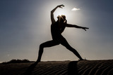 Woman in graceful asana against sunshine - 234438048