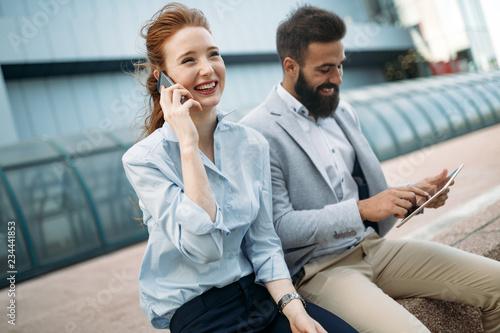Leinwandbild Motiv Picture of man and beautiful woman as business partners