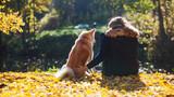Young woman on a walk with her dog breed Akita inu © Ulia Koltyrina