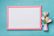 photo frame with flowers on wooden background