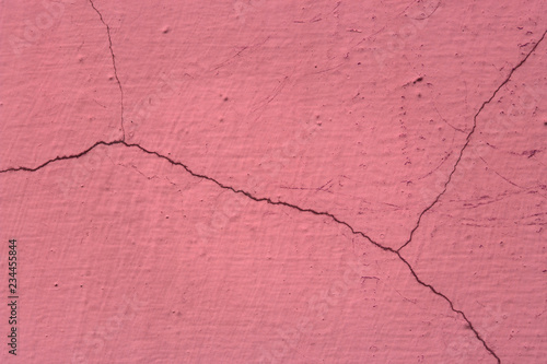 bright pink grunge texture of an old wall covered with cracks closeup - 234455844