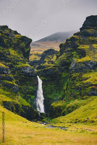 Majestic waterfall Seljalandsfoss in Iceland in autumn in cloudy weather - 234456034