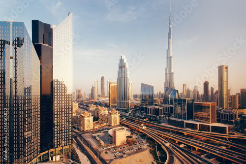 mata magnetyczna Beautiful aerial view to Dubai downtown city center skyline at sunset, United Arab Emirates