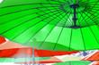 Leinwandbild Motiv Parasols couleurs sur plage
